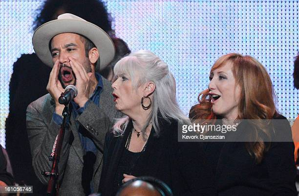 Singers Ben Harper Emmylou Harris and Patti Scialfa perform onstage at The 2013 MusiCares Person Of The Year Gala Honoring Bruce Springsteen at Los...