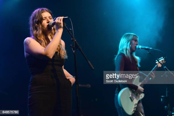 Singers Bethany Cosentino of Best Coast and Liz Phair perform onstage during the Don't Sit Down Planned Parenthood Benefit Concert at El Rey Theatre...