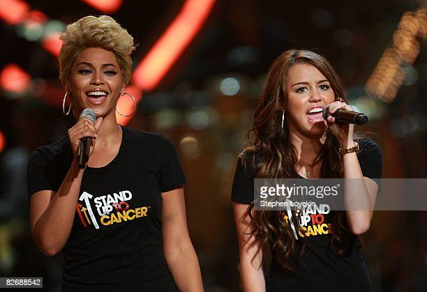 Singers Beyonce and Miley Cyrus perform on stage during the Conde Nast Media Group's Fifth Annual Fashion Rocks at Radio City Music Hall on September...