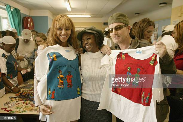 Singers Beyonce Knowles and Bono of U2 visit the Indawo Yokobelekisa Mothers 2 Mothers centre for young single mothers who have the opportunity to...