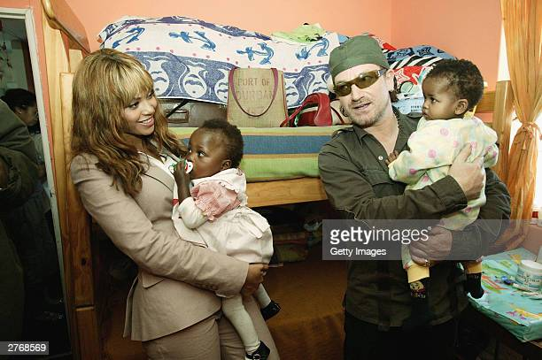 Singers Beyonce Knowles and Bono visit the Baphumelele orphanage for children with AIDS whose parents have died of AIDS prior to the 46664 Give One...