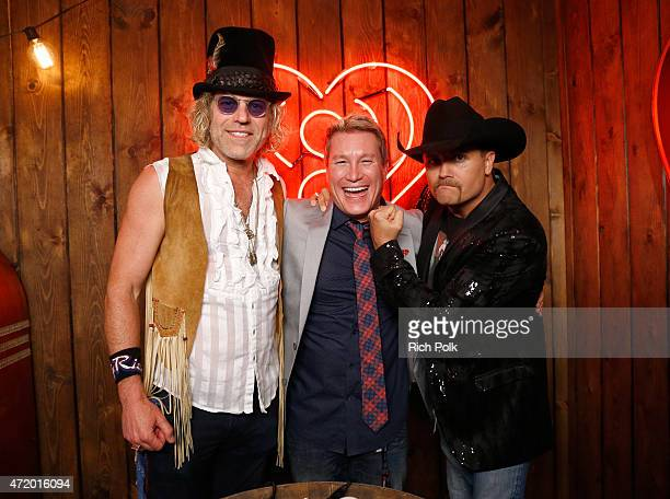 Singers Big Kenny and John Rich of Big Rich pose with radio personality Boxer backstage during the 2015 iHeartRadio Country Festival at The Frank...