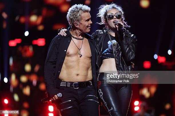 Singers Billy Idol and Miley Cyrus perform onstage at the 2016 iHeartRadio Music Festival at T-Mobile Arena on September 23, 2016 in Las Vegas,...