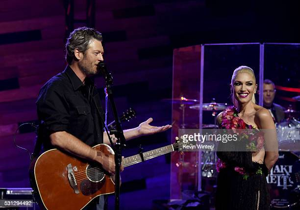 Singers Blake Shelton and Gwen Stefani perform on the Honda Stage at the iHeartRadio Theater on May 9 2016 in Burbank California