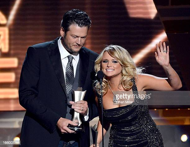 Singers Blake Shelton and Miranda Lambert accept the Song of the Year award onstage during the 48th Annual Academy of Country Music Awards at the MGM...
