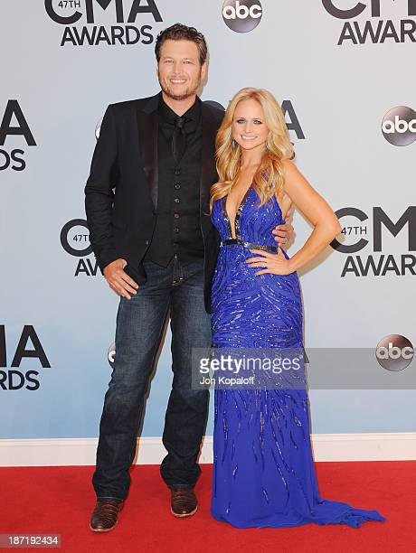Singers Blake Shelton and wife Miranda Lambert attend the 47th annual CMA Awards at the Bridgestone Arena on November 6 2013 in Nashville Tennessee