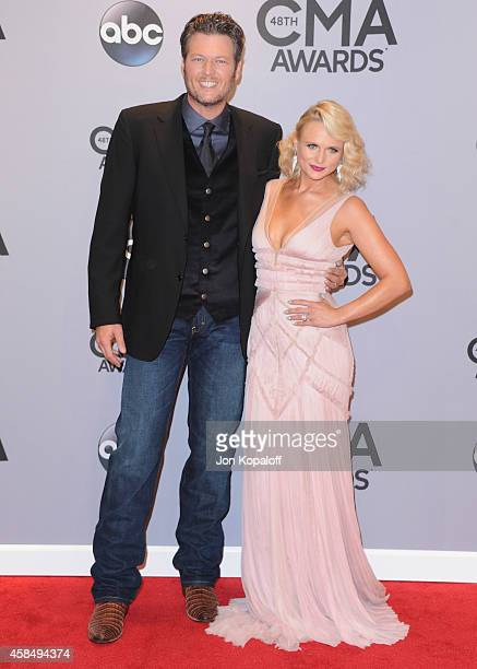 Singers Blake Shelton and wife Miranda Lambert attend the 48th annual CMA Awards at the Bridgestone Arena on November 5 2014 in Nashville Tennessee