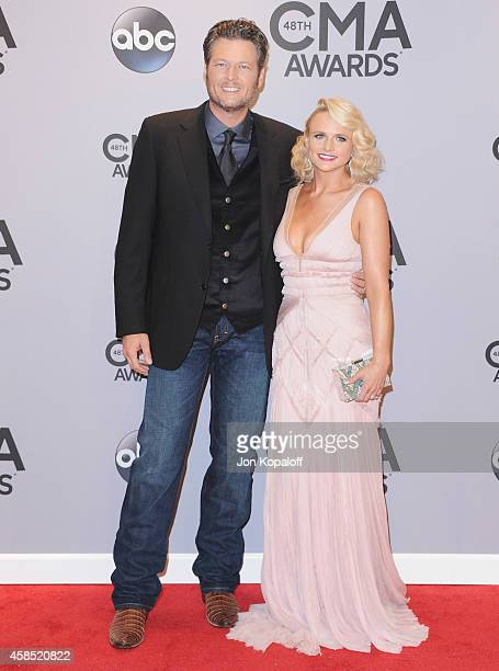 Singers Blake Shelton and wife Miranda Lambert attends the 48th annual CMA Awards at the Bridgestone Arena on November 5 2014 in Nashville Tennessee