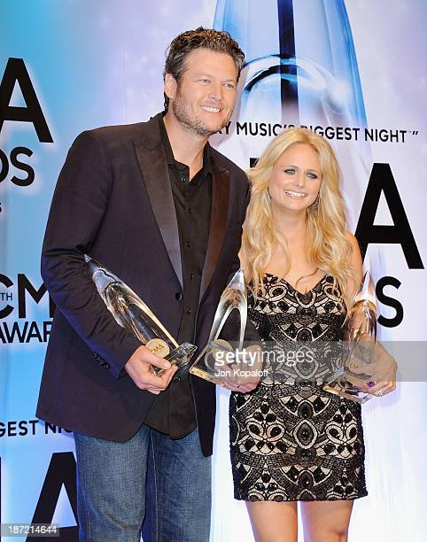 Singers Blake Shelton and wife Miranda Lambert pose in the press room at the 47th annual CMA Awards at the Bridgestone Arena on November 6 2013 in...