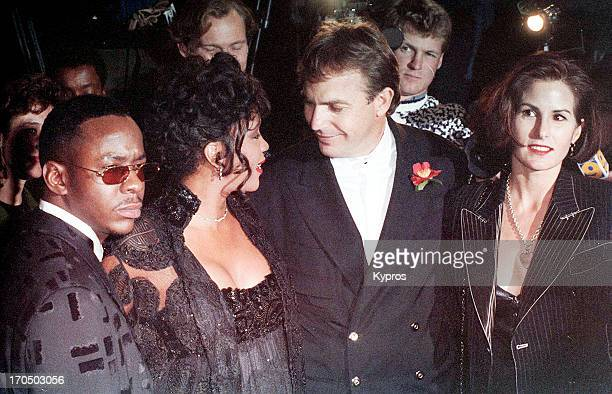 Singers Bobby Brown and Whitney Houston, and actor Kevin Costner with his wife Cindy Costner attend 'The Bodyguard' Hollywood premiere on November...