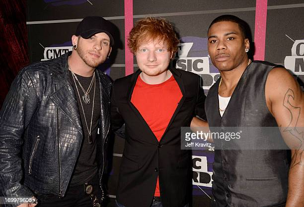 Singers Brantley Gilbert Ed Sheeran and Nelly arrive at the 2013 CMT Music Awards at the Bridgestone Arena on June 5 2013 in Nashville Tennessee