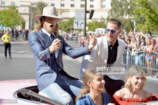 Singers Brian Kelley and Tyler Hubbard of Florida Georgia Line Hayley Stommel and Brittney Marie Cole attend the 52nd Academy Of Country Music Awards...