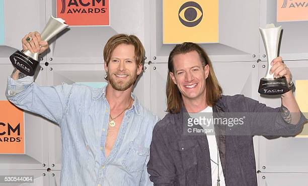 Singers Brian Kelley and Tyler Hubbard of Florida Georgia Line winners of Vocal Duo of the Year pose in the press room during the 51st Academy of...