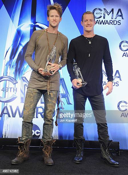 Singers Brian Kelley and Tyler Hubbard of Florida Georgia Line pose in the press room at the 49th annual CMA Awards at the Bridgestone Arena on...