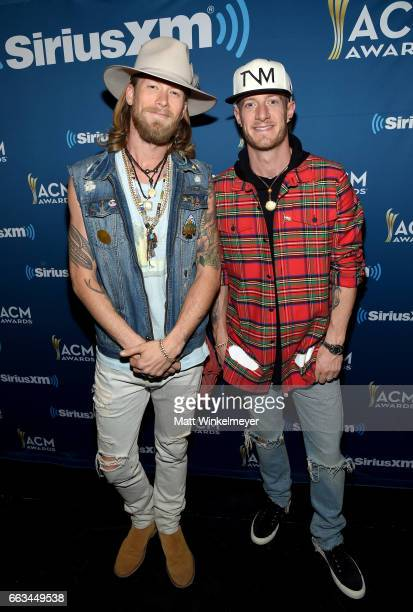 Singers Brian Kelley and Tyler Hubbard of Florida Georgia Line pose at SiriusXM's The Highway Channel broadcasts leading up to the ACM Awards at...