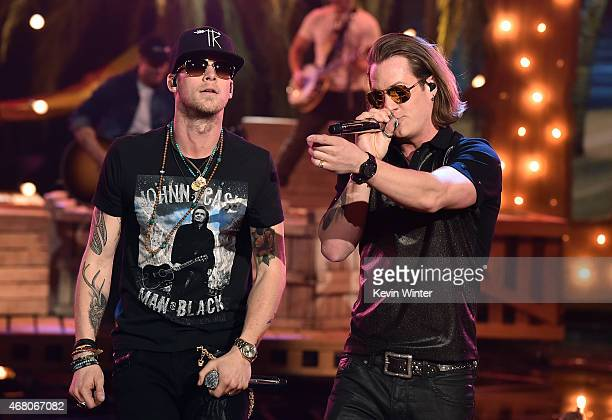 Singers Brian Kelley and Tyler Hubbard of Florida Georgia Line perform onstage during the 2015 iHeartRadio Music Awards which broadcasted live on NBC...