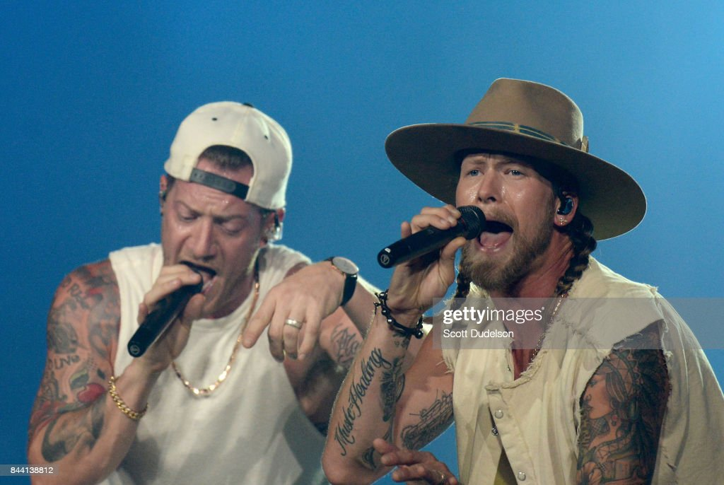 Singers Brian Kelley and Tyler Hubbard of Florida Georgia Line perform onstage during the 'Smooth' World Tour at Honda Center on September 7, 2017 in Anaheim, California.