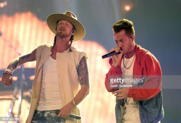 Singers Brian Kelley and Tyler Hubbard of Florida Georgia Line perform onstage during the Smooth World Tour at Honda Center on September 7 2017 in...