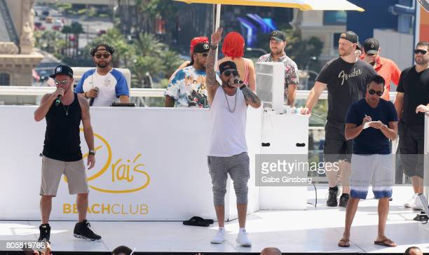 Singers Brian Littrell AJ McLean and Howie Dorough of the Backstreet Boys perform during a Fourth of July weekend celebration at Drai's Beach Club...