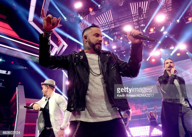 Singers Brian Littrell AJ McLean and Kevin Richardson of Backstreet Boys perform onstage during the 52nd Academy of Country Music Awards at TMobile...
