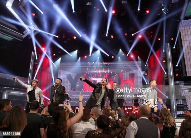 Singers Brian Littrell AJ McLean Kevin Richardson and Howie D of the Backstreet Boys perform with singer Tyler Hubbard of Florida Georgia Line...