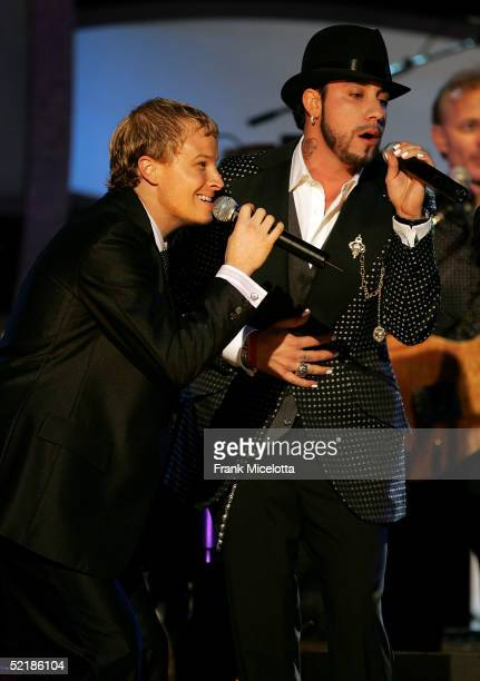 Singers Brian Littrell and AJ McClean of the Backstreet Boys perform onstage at the MusiCares 2005 Person of the Year Tribute to Brian Wilson at the...