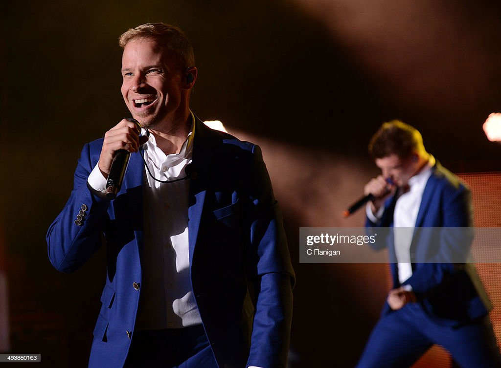 Singers Brian Littrell and Nick Carter of the Backstreet Boys perform during the 'In a World Like This' summer tour at Shoreline Amphitheatre on May 25, 2014 in Mountain View, California.