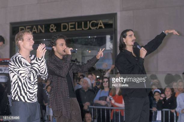 Singers Brian Littrell Howie Dorough and Kevin Richardson of the Backstreet Boys perform at 'The Today Show' Summer Concert Series on July 2 2001 at...