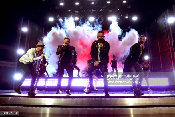 Singers Brian Littrell Nick Carter AJ McLean and Kevin Richardson of Backstreet Boys perform onstage during the 52nd Academy of Country Music Awards...