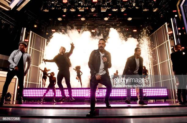Singers Brian Littrell Nick Carter AJ McLean Kevin Richardson and Howie Dorough of Backstreet Boys perform onstage during the 52nd Academy of Country...