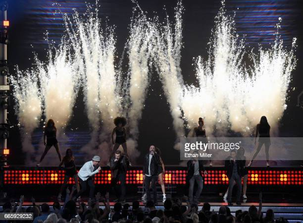 Singers Brian Littrell Nick Carter AJ McLean Kevin Richardson and Howie Dorough of the Backstreet Boys perform during the 52nd Academy of Country...
