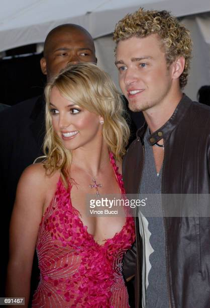 Singers Britney Spears and Justin Timberlake attend the 29th Annual American Music Awards at the Shrine Auditorium January 9 2002 in Los Angeles CA