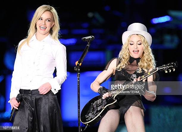 Singers Britney Spears and Madonna perform on Madonna's 'Sticky Sweet' Tour at Dodger Stadium on November 6 2008 in Los Angeles California