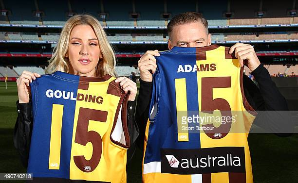 Singers Bryan Adams and Ellie Goulding pose with Aussie Rules Football guernseys during a 2015 AFL Grand Final Entertainment Media Opportunity at the...