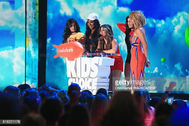 Singers Camila Cabello Normani Kordei Ally Brooke Lauren Jauregui and Dinah Jane of Fifth Harmony accept the Favorite Music Group Award onstage...