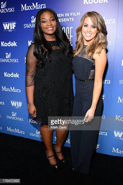 Singers Candice Glover and Angie Miller pose backstage at Women In Film's 2013 Crystal Lucy Awards at The Beverly Hilton Hotel on June 12 2013 in...
