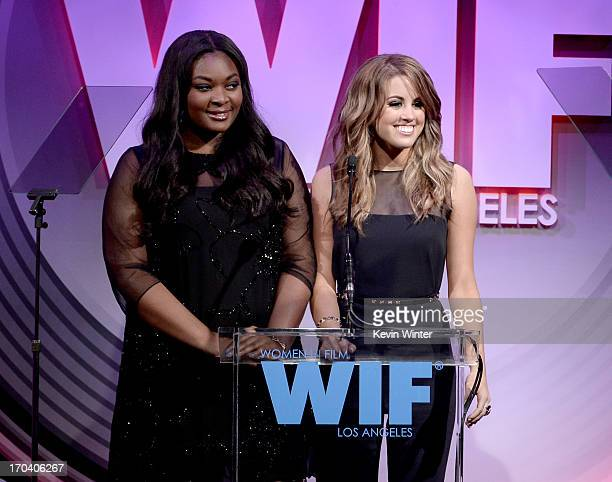Singers Candice Glover and Angie Miller speak onstage during Women In Film's 2013 Crystal Lucy Awards at The Beverly Hilton Hotel on June 12 2013 in...