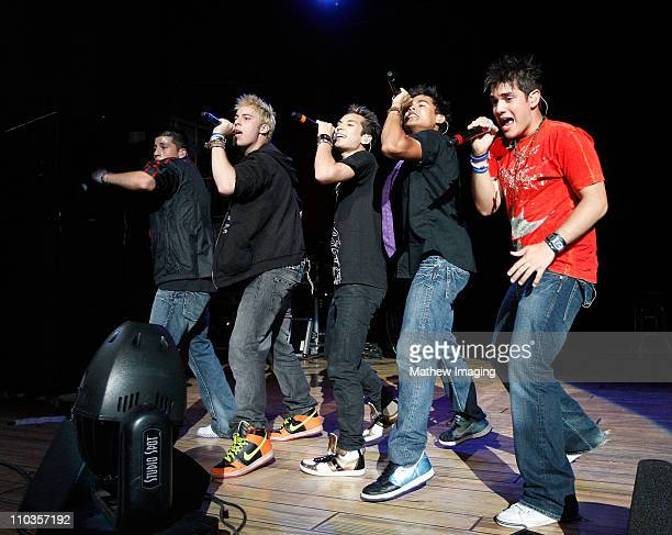 COVERAGE* Singers Carlos Jose Chris Monti and Emmanuel of Menudo perform at the Golden Bear Theatre at Six Flags Magic Mountain on July 13 2008 in...