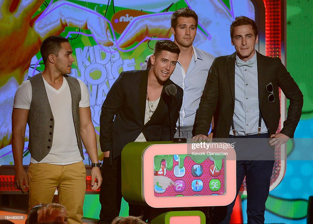 Singers (L-R) Carlos Pena Jr., Logan Henderson, Jason Maslow and Kendall Schmidt of Big Time Rush speak onstage during Nickelodeon's 26th Annual Kids' Choice Awards at USC Galen Center on March 23, 2013 in Los Angeles, California.