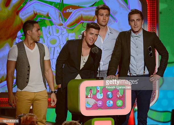 Singers Carlos Pena Jr Logan Henderson Jason Maslow and Kendall Schmidt of Big Time Rush speak onstage during Nickelodeon's 26th Annual Kids' Choice...