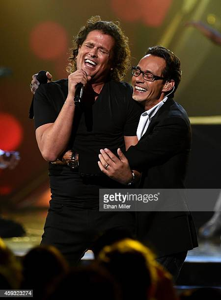Singers Carlos Vives and Marc Anthony perform onstage during the 15th Annual Latin GRAMMY Awards at the MGM Grand Garden Arena on November 20 2014 in...