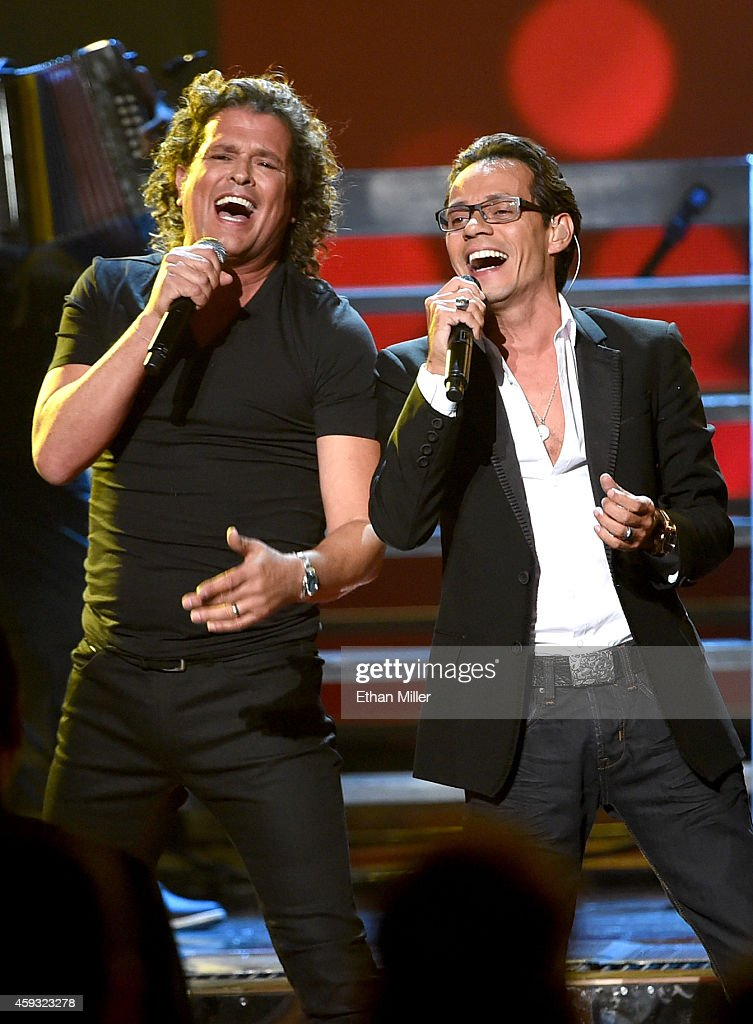Singers Carlos Vives (L) and Marc Anthony perform onstage during the 15th Annual Latin GRAMMY Awards at the MGM Grand Garden Arena on November 20, 2014 in Las Vegas, Nevada.