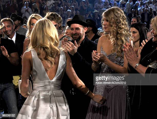 Singers Carrie Underwood and Taylor Swift hug in the audience during the 45th Annual Academy of Country Music Awards at the MGM Grand Garden Arena on...