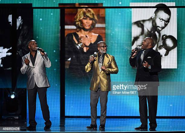 Singers Carvin Winans BeBe Winans and Marvin Winans of 3 Winans Brothers perform during the 2014 Soul Train Music Awards at the Orleans Arena on...