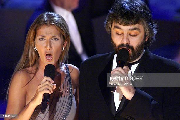 Singers Celine Dion and Andrea Boccelli perform at the 41st Grammy Awards at the Shrine Auditorium in Los Angeles 24 February AFP PHOTO/Hector MATA