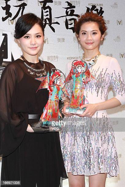 Singers Charlene Choi and Gillian Chung of Twins pose backstage during the 17th Channel V Chinese Music Awards at Venetian Theatre on April 18 2013...