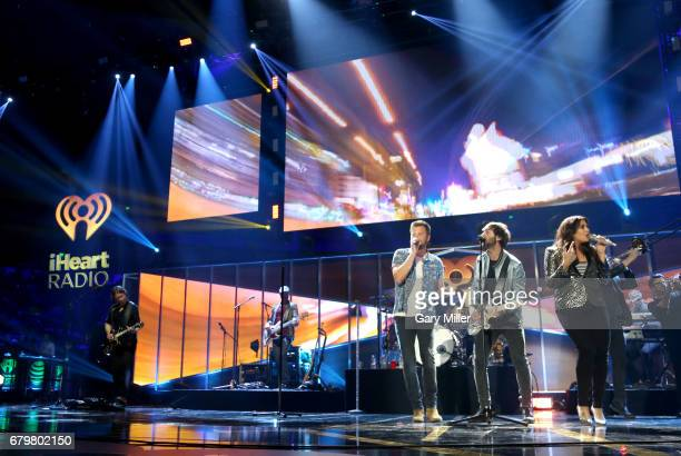 Singers Charles Kelley Dave Haywood and Hillary Scott of Lady Antebellum perform onstage during the 2017 iHeartCountry Festival A Music Experience by...