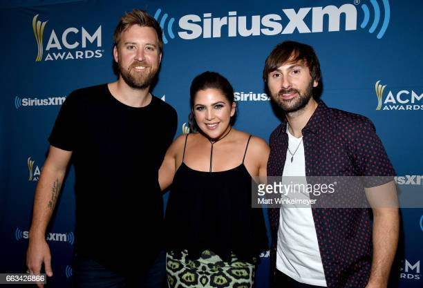 Singers Charles Kelley Hillary Scott and Dave Haywood of Lady Antebellum pose at SiriusXM's The Highway Channel broadcasts leading up to the ACM...