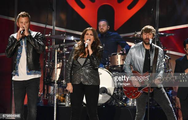 Singers Charles Kelley Hillary Scott and Dave Haywood of Lady Antebellum perform onstage during the 2017 iHeartCountry Festival A Music Experience by...