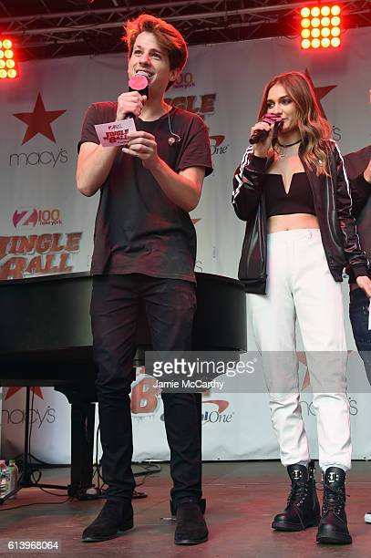 Singers Charlie Puth and Daya speak onstage during the Jingle Ball 2016 Official Kick Off Event presented by Capital One at Macy's Herald Square on...